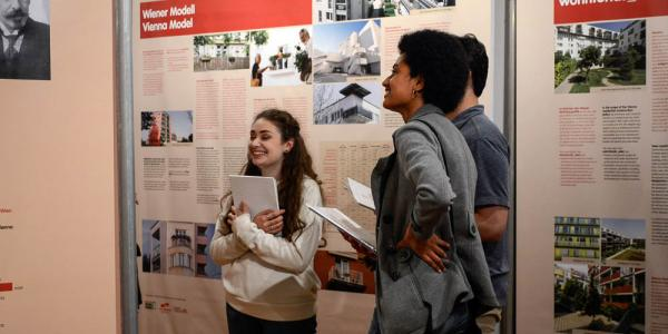 Students at Social Housing exhibit