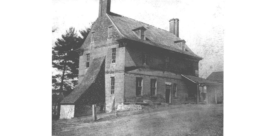 1890, black and white image of the Bostwick House, with a buttress.